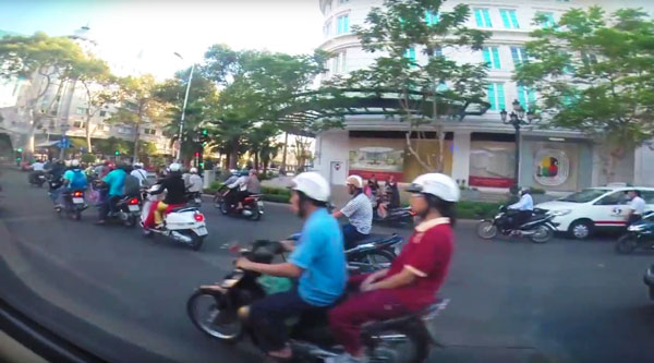 "The never-ending game of ""chicken"" crossing the streets in Saigon. Terrifying!!!!"